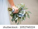 wedding love rose in woman's... | Shutterstock . vector #1052760224