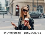 pretty girl stand on the street ... | Shutterstock . vector #1052800781