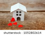 miniature white toy house with... | Shutterstock . vector #1052802614