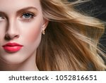 woman with curly long hair... | Shutterstock . vector #1052816651