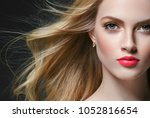 woman with curly long hair... | Shutterstock . vector #1052816654