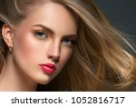 woman with curly long hair... | Shutterstock . vector #1052816717