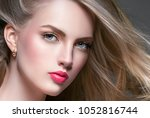 woman with curly long hair... | Shutterstock . vector #1052816744