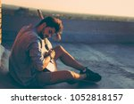 guy playing the guitar on a... | Shutterstock . vector #1052818157