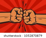 two clenched fists bumping...   Shutterstock .eps vector #1052870879