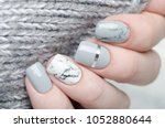 white grey marble manicure with ... | Shutterstock . vector #1052880644
