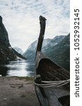 Small photo of Old viking boat replica in a Norwegian landscape near Flam, Norway.