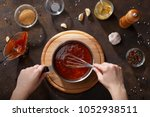 hands mix the bbq sauce with...   Shutterstock . vector #1052938511