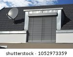 roof with metal plated dormer... | Shutterstock . vector #1052973359