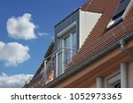roof with metal plated dormer... | Shutterstock . vector #1052973365