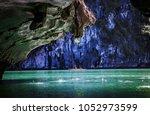 kayaking among caves and lagoon ... | Shutterstock . vector #1052973599