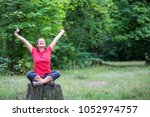 woman in her 50s sitting on a... | Shutterstock . vector #1052974757