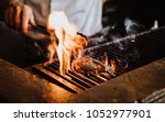 steak on the grill with flames | Shutterstock . vector #1052977901