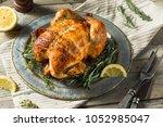 homemade rotisserie chicken... | Shutterstock . vector #1052985047