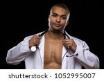 studio portrait of a young... | Shutterstock . vector #1052995007