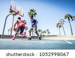 Two Basketball Players Playing...