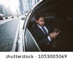business man in his limousine | Shutterstock . vector #1053005069