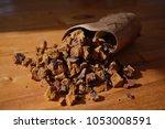 wild chaga mushroom chunks in a ...   Shutterstock . vector #1053008591