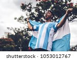 argentinian fan celebrating... | Shutterstock . vector #1053012767