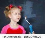 little funny smiling girl paint ... | Shutterstock . vector #1053075629