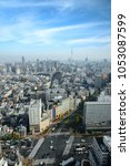 cityscapes of tokyo in fog... | Shutterstock . vector #1053087599