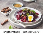 salad from boiled beet  young... | Shutterstock . vector #1053092879