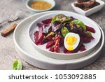 salad from boiled beet  young... | Shutterstock . vector #1053092885