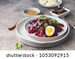 salad from boiled beet  young... | Shutterstock . vector #1053092915