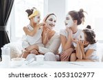 mom with her daughters making... | Shutterstock . vector #1053102977