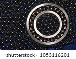 Small photo of spherical bearing in the background of bearing balls