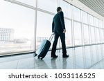 man at the airport with... | Shutterstock . vector #1053116525