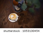 latte coffee in white cup on... | Shutterstock . vector #1053130454