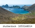 village bay on the remote and... | Shutterstock . vector #1053168014