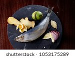 herring entirely with ginger... | Shutterstock . vector #1053175289