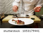 chef is adding molecular caviar ... | Shutterstock . vector #1053179441