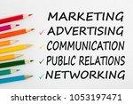 marketing written on a white... | Shutterstock . vector #1053197471