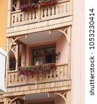 wooden balconies and flower beds | Shutterstock . vector #1053230414