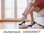 woman changing high heels ... | Shutterstock . vector #1053240077