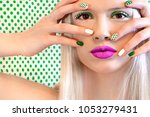 nail design and makeup with... | Shutterstock . vector #1053279431