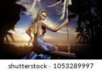 young blond woman posing in a... | Shutterstock . vector #1053289997