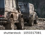 suv covered with mud stands... | Shutterstock . vector #1053317081