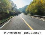 woodland mountain road    Shutterstock . vector #1053320594