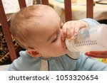 Cute Baby Drinking From Bottle