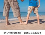 father and son standing on the... | Shutterstock . vector #1053333395