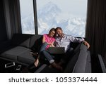 young couple relaxing at  home... | Shutterstock . vector #1053374444