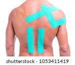 muscular man with adhesive tape ... | Shutterstock . vector #1053411419