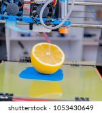 ripe slice of yellow lemon... | Shutterstock . vector #1053430649