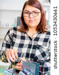 female apprentice working on... | Shutterstock . vector #1053430661