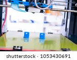 3d printer of the device during ... | Shutterstock . vector #1053430691