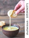 bowl of cheese dip with toasts   Shutterstock . vector #1053436571